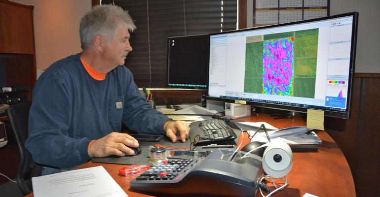 Gary Wagner studies a yield map