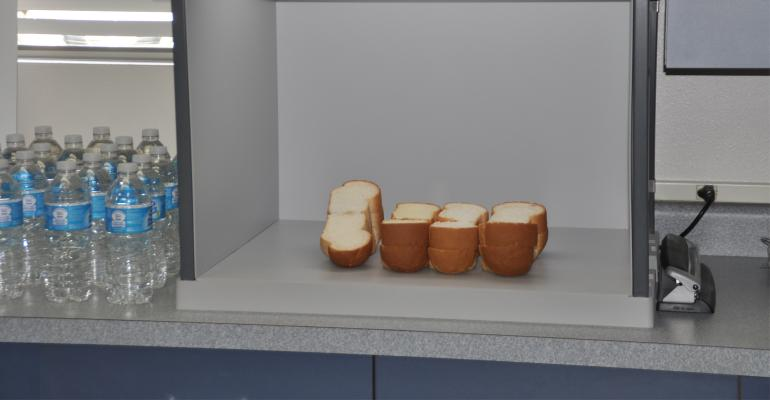 cut bread and water on counter in office
