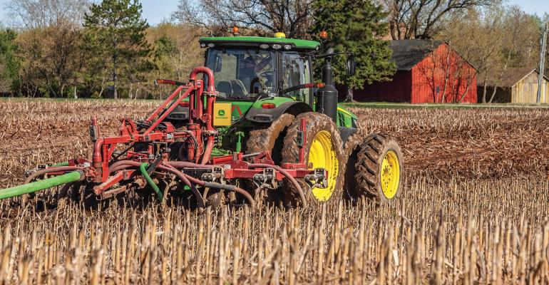 tractor applying manure in field