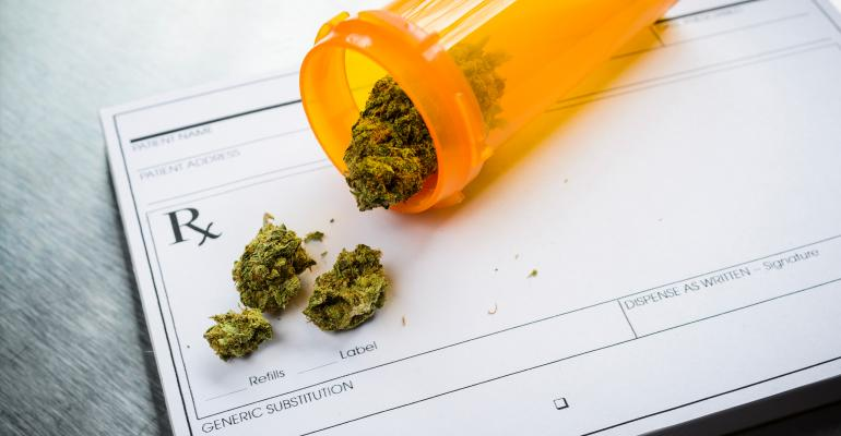 Bottle of marijuana spills onto doctor's prescription pad