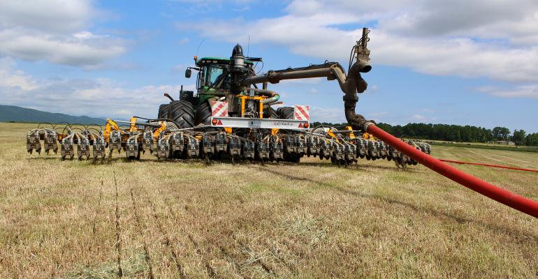 Manure injection in hay field