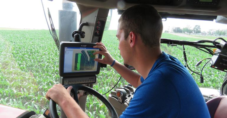farmer in cab looking at GPS