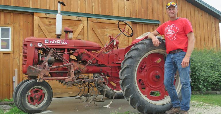 Roger Basse and Farmall Super C tractor