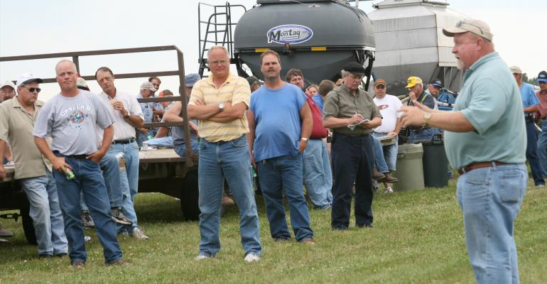 Jim Gillespie (far right in photo) talking to a group of people at field day