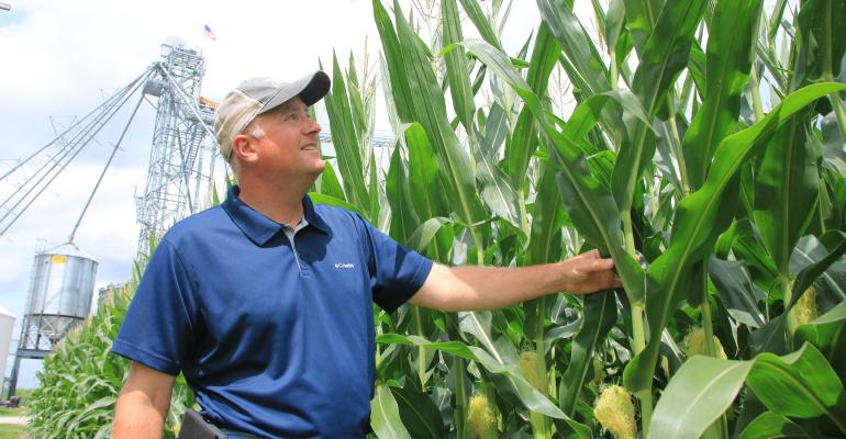 Marc Padrutt next to tall corn