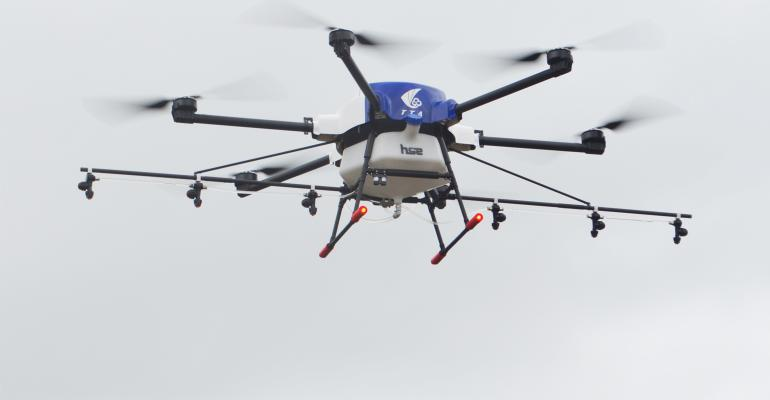 Close up of an agricultural drone shown in flight