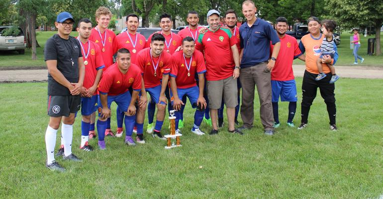 Sioux River Dairy soccer team with trophy