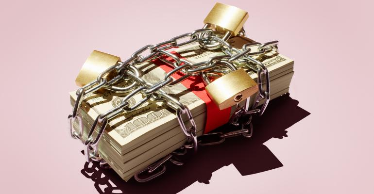 stack of money wrapped in chains