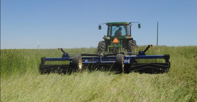Scott Heinemann, Winside, Neb., in field with roller-crimper this year to terminate a standing rye cover crop with soybeans growing under the rye matt
