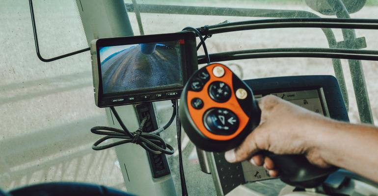 multifunctional hydro joystick controller in a combine cab