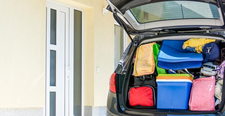 car with hatchback packed with bags