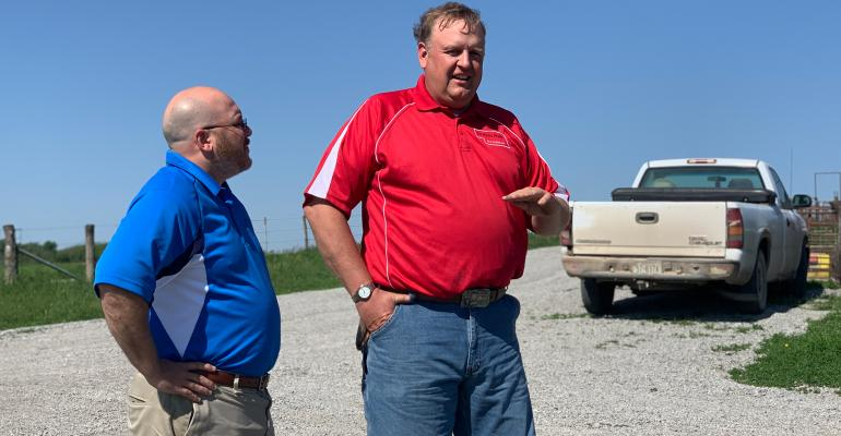 Travis Dunekacke, owner of TD Niche Pork in Elk Creek, talks with Nate Blum of the Nebraska Grain Sorghum Board.
