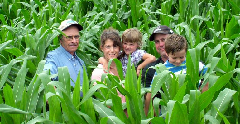 David, Sarah, Audrey, Walker and Kaiden Fitch stand together in the middle of a corn field