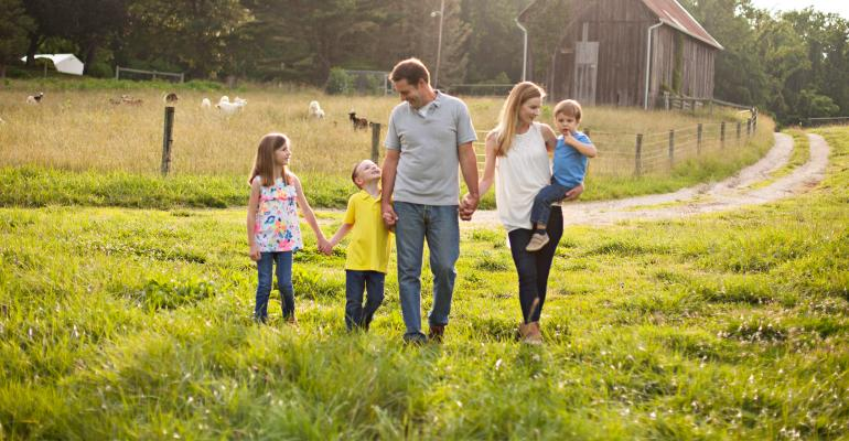 Jamie Clark Tiralla shown walking with her husband Benson, daughter Caroline and sons Henry and Issac at Monnett Farms