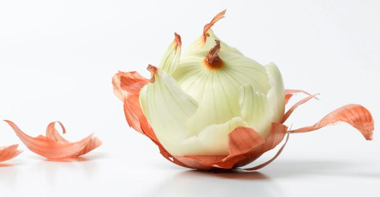 A peeled onion with an isolated white background