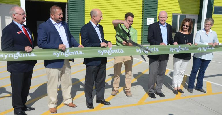 At center, site manager Joe Bevilacqua cuts the ribbon for Syngenta's new Trait Conversion Accelerator at Nampa, Idaho. Tom Kealey, Idaho director of commerce; Kevin Ross, first vice president of the National Corn Growers Association and farmer from Minde