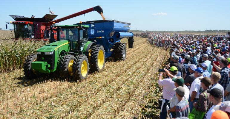 Combines and auger wagons at Farm Progress Show field demos
