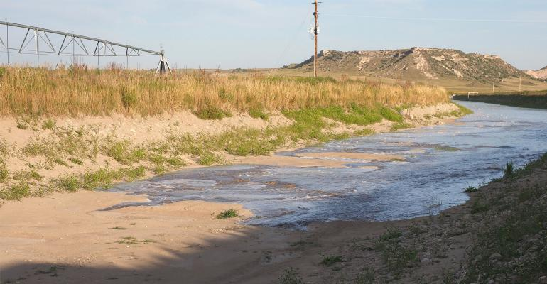 : On August 29, water returned to the repaired tunnel supplying water to 107,000 acres of irrigated crop ground in eastern Wyoming and western Nebraska.