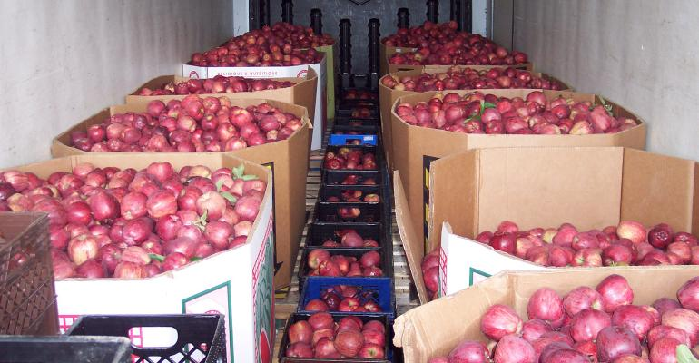 boxes of apples in storage