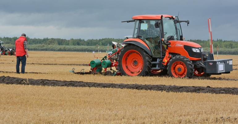 tractor and plow in stubble ground