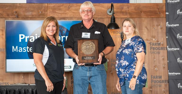 Holly Spangler presents Kenneth Hartman Jr. and wife Anita with the Master Farmer award