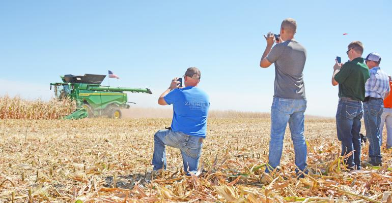 Five farmers were on hand at the Husker Harvest Days show site in Nebraska to inspect hay equipment and cattle chutes