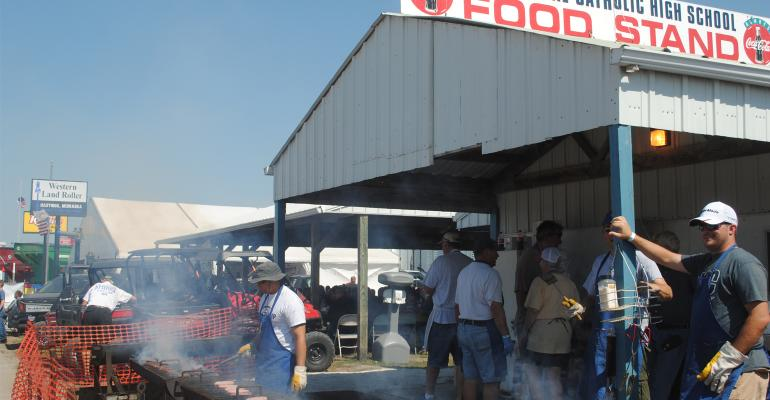 : Volunteers work at several food stands across the HHD grounds, cooking up great food for show visitors to raise money for their specific school and youth programs.
