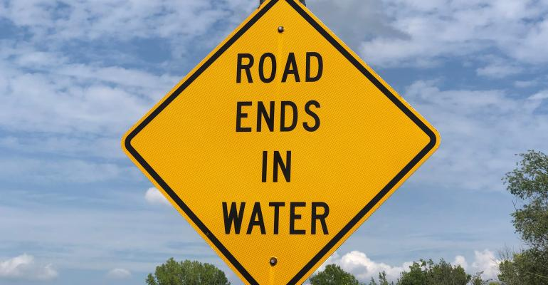 road ends in water sign