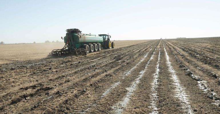 Manure application being applied in field