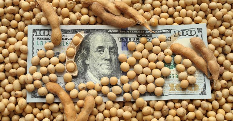 Agricultural concept, heap of soy beans and dollar banknotes