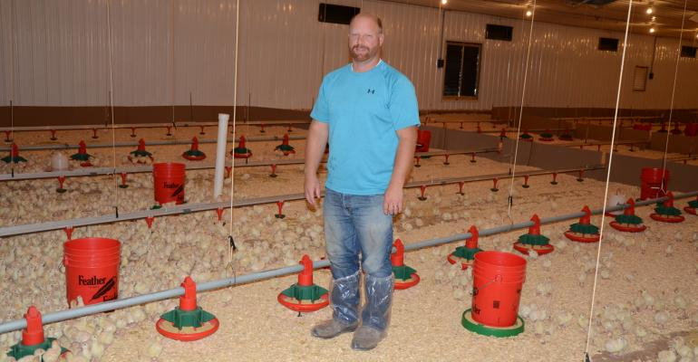 Caleb Duflo of Four D Farms in Carson City, Mich. with two-day old turkey poults