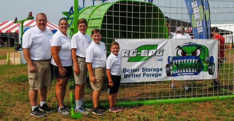 Randy and Wendy Clark show off their new T-7170 Ag-Bag with their three sons Ryan Wisconsin Farm Technology Days