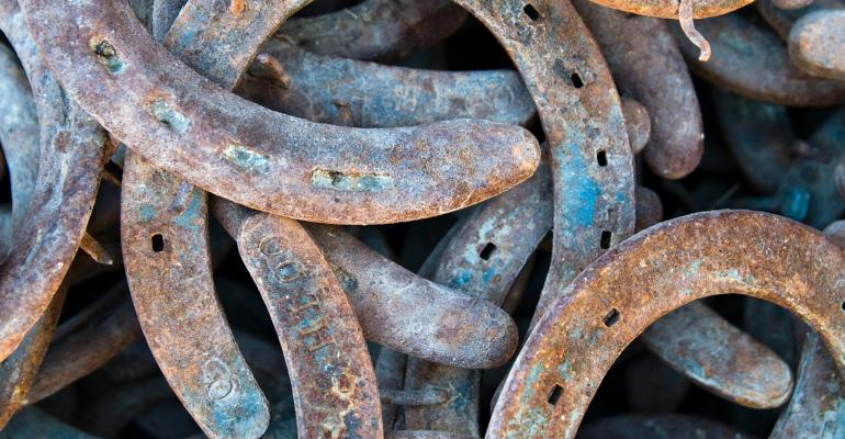 A pile of used horseshoes