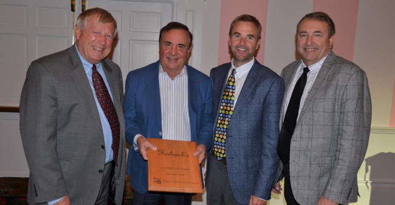 MABA President Jim Byrum awards, from left, Stephen, Herb and Greg Herbruck with the 2019 Leaders and Legends award.