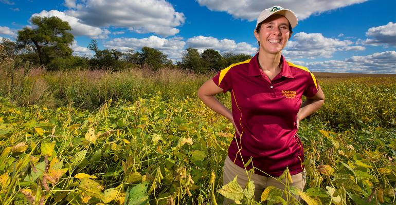 Lisa Schulte Moore, a professor at Iowa State University, stands in a soybean field