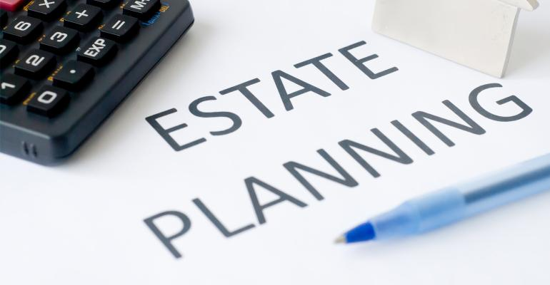 Calculator and pen with estate planning