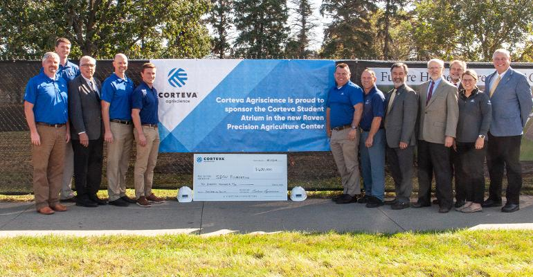 Corteva Agriscience presents the SDSU Foundation with a check to sponsor the Corteva Student Atrium in the Raven Precision Agriculture Center.