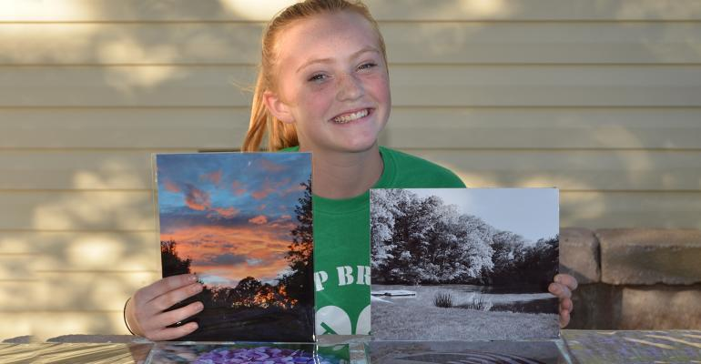 Ally Duncan with photography project photos