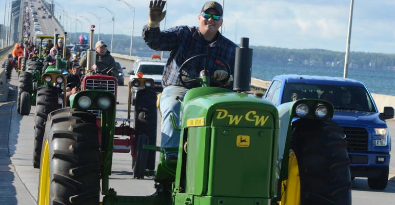 The Mackinac Bridge Antique Tractor Crossing continues to draw more and more drivers and buddy riders