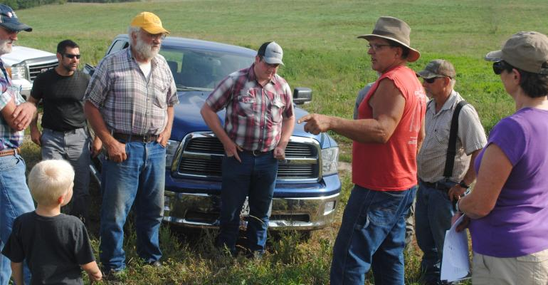 Pat Steffen and his wife, Julie  share the details of their grass-based farming operation with other grazing enthusiasts on a recent pasture walk