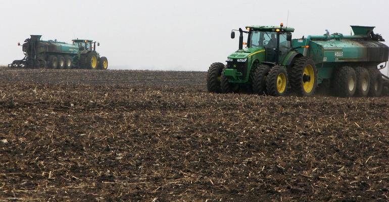 tractos testing manure in field