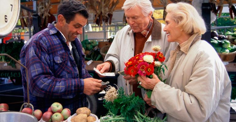 Elderly couple purchasing flowers at a farmer's market