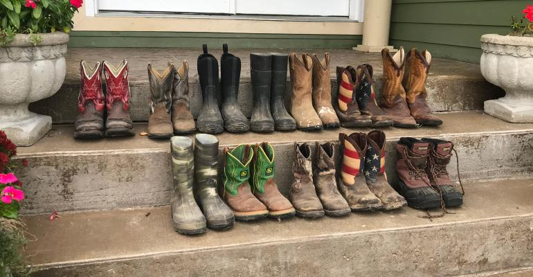 several pairs of boots lined up on steps