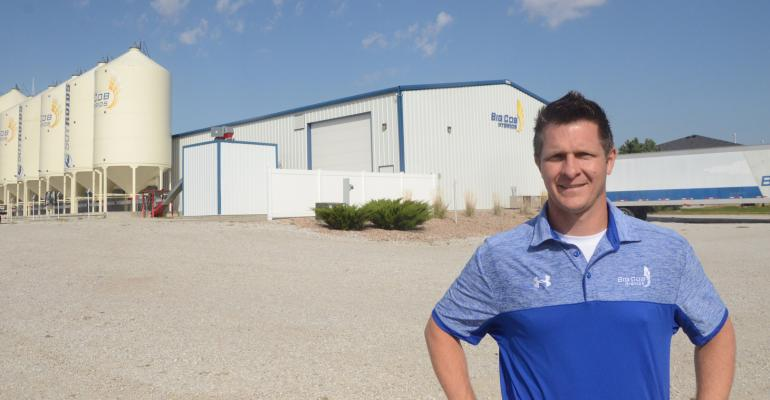 Ben Benson, Big Cob Hybrids president and owner, stands in front of one of the company's warehouses at its headquarters in Seward, Neb