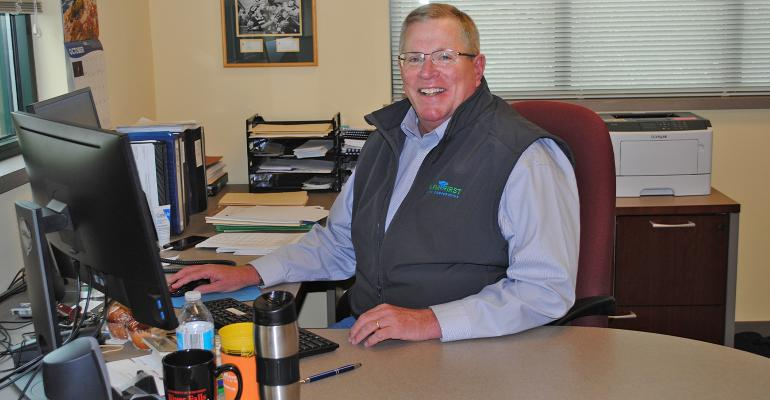 Jeff Lyon, general manager of FamilyFirst Dairy Cooperative, seated at desk