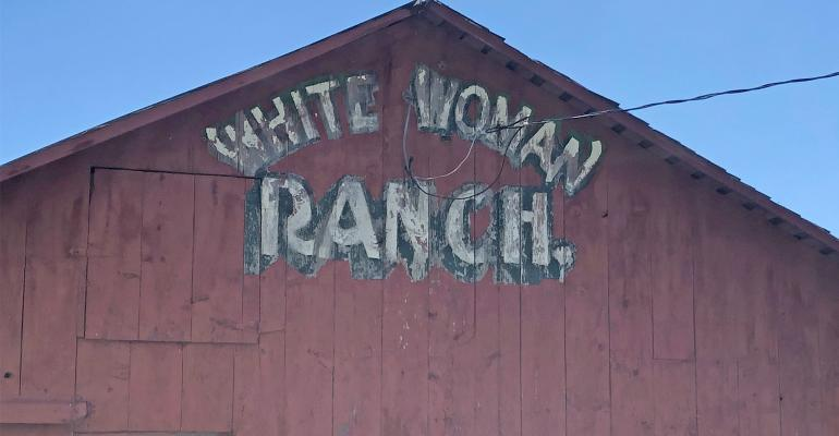 White Woman Ranch painted on a barn