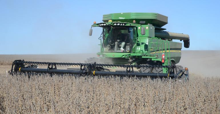A photo from 2018 in which Jimmy Frederick harvests 138-bushel rainfed soybeans – with planting populations around 50,000 plants per acre.