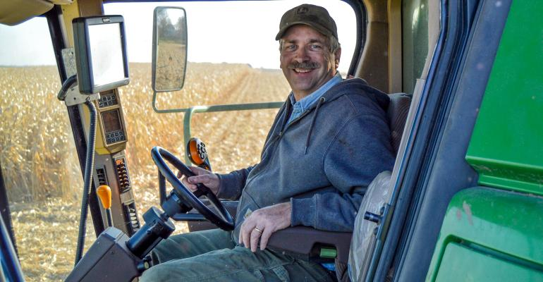 Rod Weinzierl sitting in cab of combine