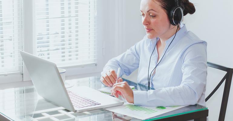 woman with headphones at laptop