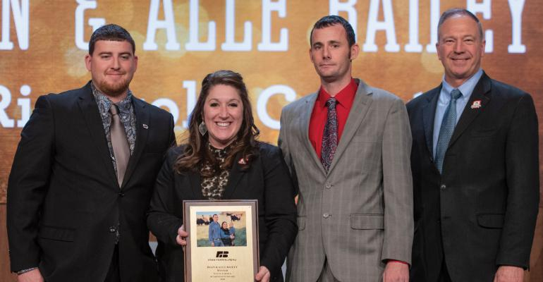 Alle and Ryan Bailey (center) won first place in the 2018 IFBF Young Farmer Leadership contest. Committee chair Michael Jackson (left) and IFBF President Craig Hill (right) presented the award